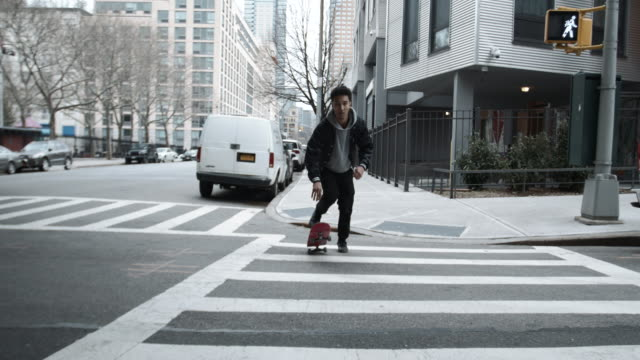 A real person skateboards through the streets of Brooklyn, NYC - 4k