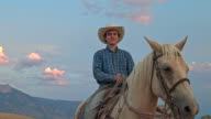 Real time video of Cowboy on his Horse looking at camera