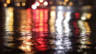 Really cool blurred street shot with lights changing and rain hitting the ground