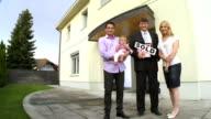 HD CRANE: Realtor Posing With A Family