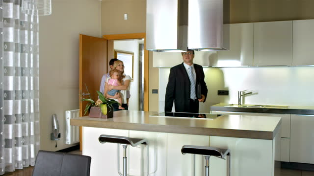HD: Realtor Showing The features Of A Kitchen