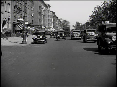 B/W rear car point of view in traffic on NYC street