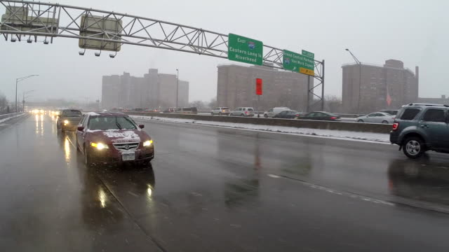 (Rear POV) Driving On The Highway During A Snowstorm
