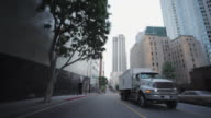 Rear POV driving through downtown Los Angeles