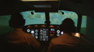 MS rear internal view of pilots and instrument panel in professional flight simulator during climbing flight, RED R3D 4K