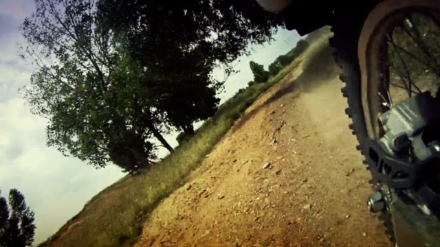 Rear on-board camera on motocross motorbike riding in the dirt