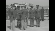 Rear shot Col V H Kimble Commanding Officer of the Air Corps Advanced Flying School at Tuskegee Institute presents wings to the first class of...