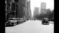 Rear view driving north on Fifth Avenue past Central Park Rear view driving north on Fifth Avenue on January 01 1938 in New York New York