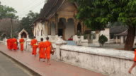 WS Rear view of Buddhist monks walking at Buddhist Temple at Haw Kham / Luang Prabang, Laos