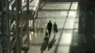 WS HA Rear view of business couple walking through lobby / Bangkok, Thailand