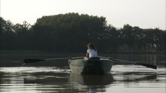 WS Rear view of girl (10-11) in boat, Bouillon, Belgium