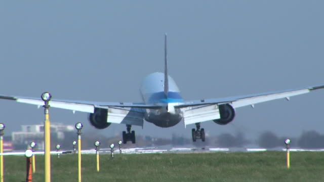 Rear view of jet landing at Heathrow with no clearly noticeable view of livery or branding Eventually turns at end of clip after landing to show ANA...