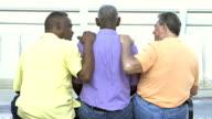Rear view of three multi-ethnic senior men on bench