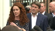 Rebekah Brooks answering press question regarding phone hacking and then walk off with husband Charlie Brooks