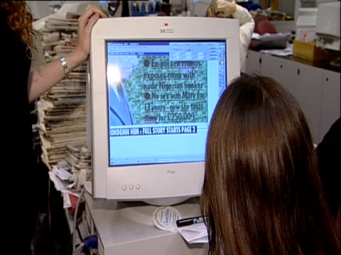 Rebekah Brooks oversees the front page layout of the News of the World newspaper 2001