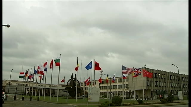 International reaction EXT Long shot general view of NATO headquarters International flags flying including Union Jack