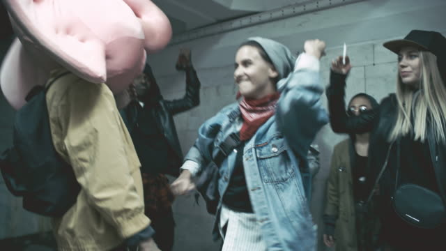 Rebellious young people raving inside underground crossing