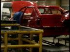 Car Sales Price Cuts Ellesmere Port GV Men working on cars and vans in Vauxhall Plant BV Shell of car as men working on it ITN