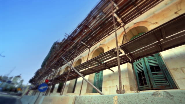 Reconstruction of old building with scaffolding