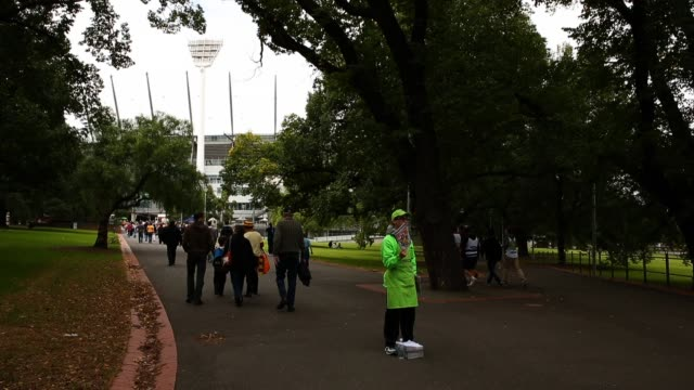 Record sellers sell programs as the crowd arrives for the Round 1 AFL match between the Hawthorn Hawks and Geelong Cats at the Melbourne Cricket...
