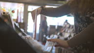 Record store employee arranges vinyl records in downtown shop.