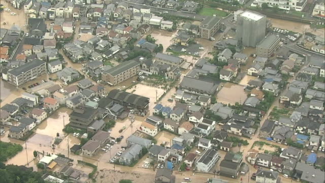 Record torrential rain hits western parts of Japan and in the city of Hiroshima more than 70 people have died in massive landslides