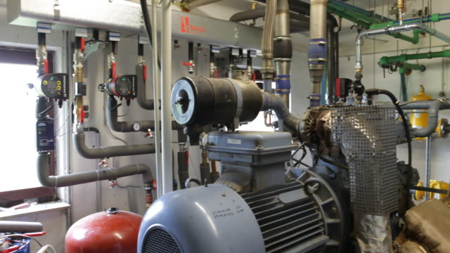 Recording of the machine room with several pumps and equipment of a biogas plant in northern Germany in Schleswig Holstein