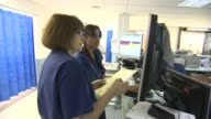 NHS records worst ever results on waiting times NHS records worst ever results on waiting times INT Ambulance worker pushes empty trolley along...
