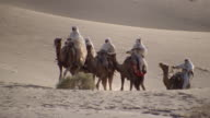 MS, Re-creation, Africa, Tuareg warriors riding camels in desert