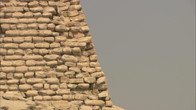 Rectangular stones comprise the ancient Saqqara Pyramid in Egypt.