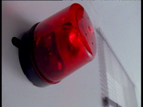 Red alarm light turns and flashes in science lab