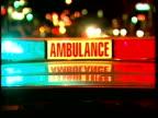 CU Red and blue flashing lights of ambulance