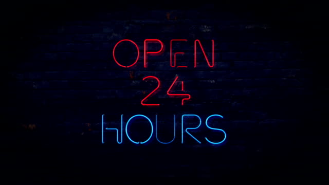 Red and blue Open 24 Hours flashing neon sign
