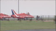 family pays tribute ENGLAND Lincolnshire RAF Scampton EXT Investigators examining Red Arrows Hawk jet on tarmac