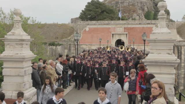 MS Red band crossing bridge on easter parade AUDIO / Kerkyra, Corfu, Greece