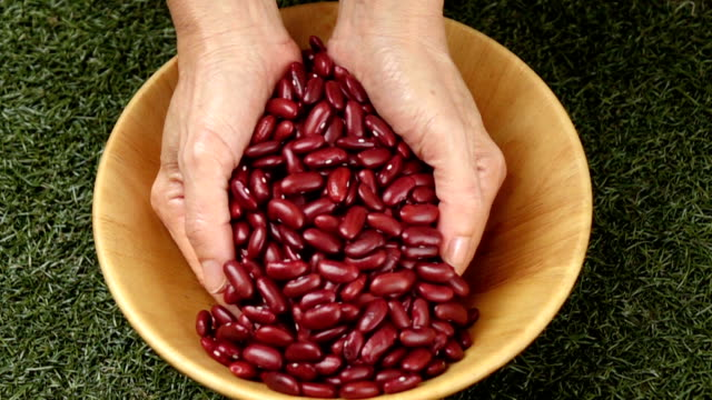 Red beans flow in slow motion