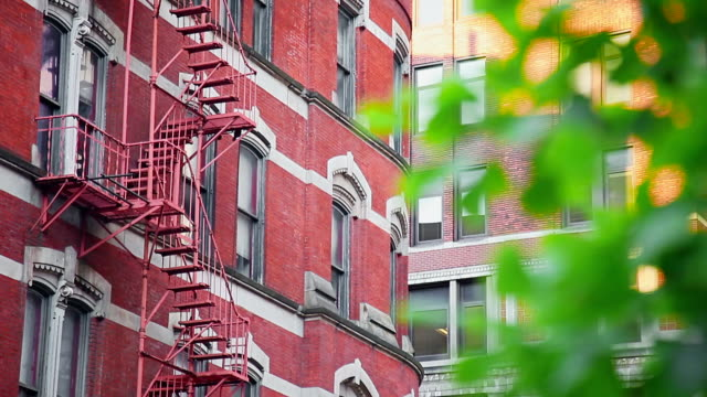 Red building facade with fire escape