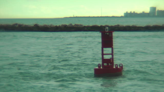 Red buoy floating in the harbor area