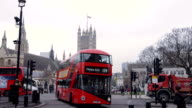 Red Buses turns right at Parliament square in slow motion