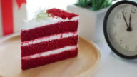 Red cake Strawberries cream cake on wooden dish on white table , dolly shot tilt up