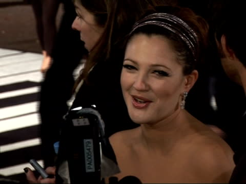 Red carpet interviews at Leicester Square premiere of 'Music and Lyrics' Drew Barrymore speaking to press / long shot of Grant next Barrymore...