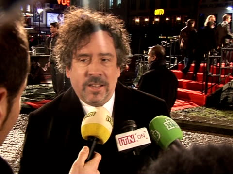 Red carpet interviews at Sweeney Todd premiere Tim Burton speaking to press SOT On blood and gore in film / It's our own special recipe that we use /...