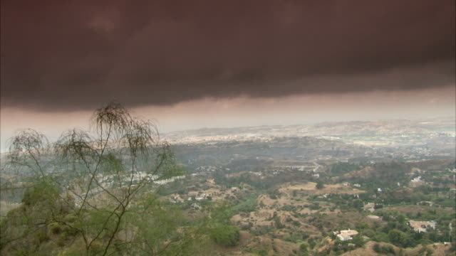 Red clouds hang over the Mijas countryside in Spain.