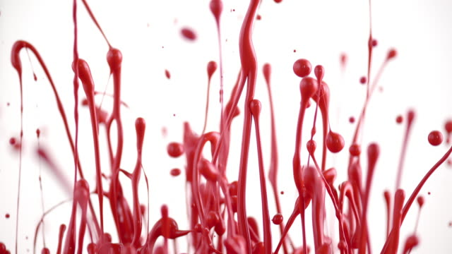 SLO MO Red color lifted into air creating beautiful sculptures