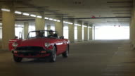 Red Convertible Transforms into a Suitcase
