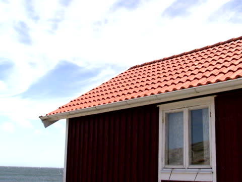 A red cottage a sunny day Bohuslan Sweden.