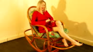 red dresses woman with rocking chair