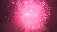 Red fireworks explode, Japan