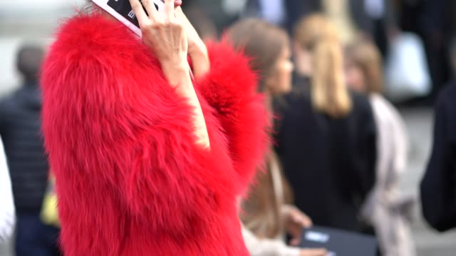 A red fur coat outside the Lemaire show during Paris Fashion Week Womenswear Spring/Summer 2018 on September 27 2017 in Paris France