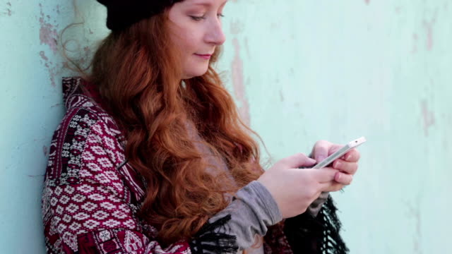 Red hair woman with smart phone